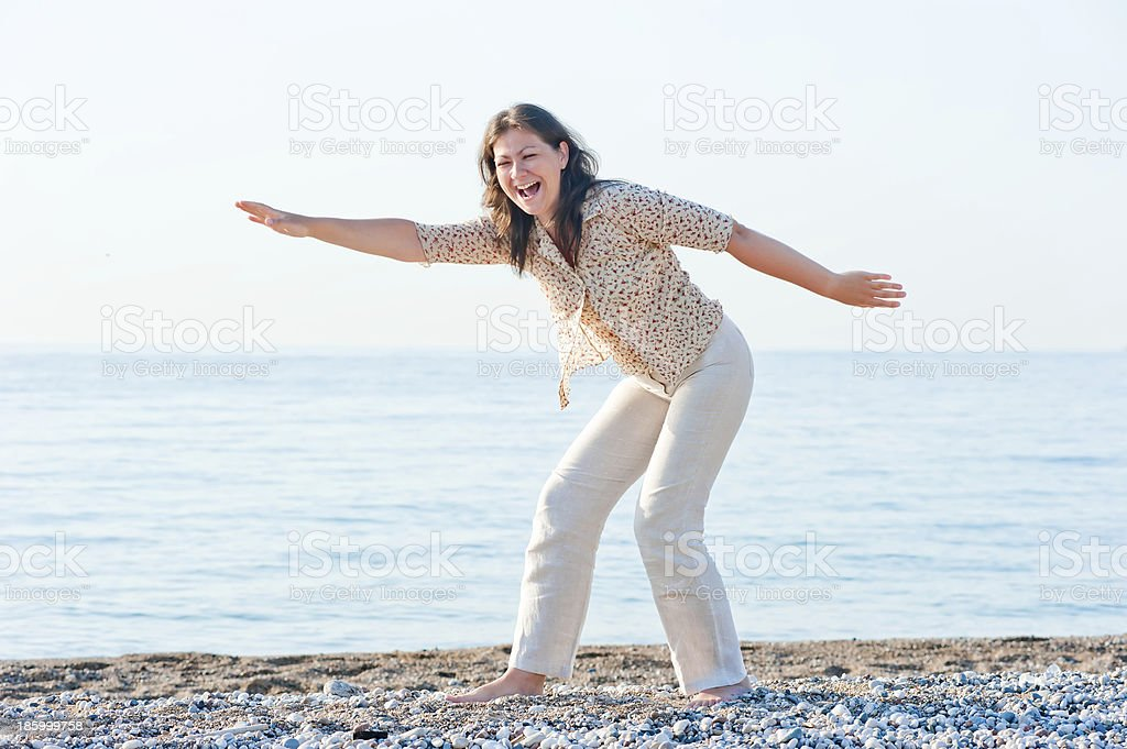 young girl on the beach fooling around royalty-free stock photo