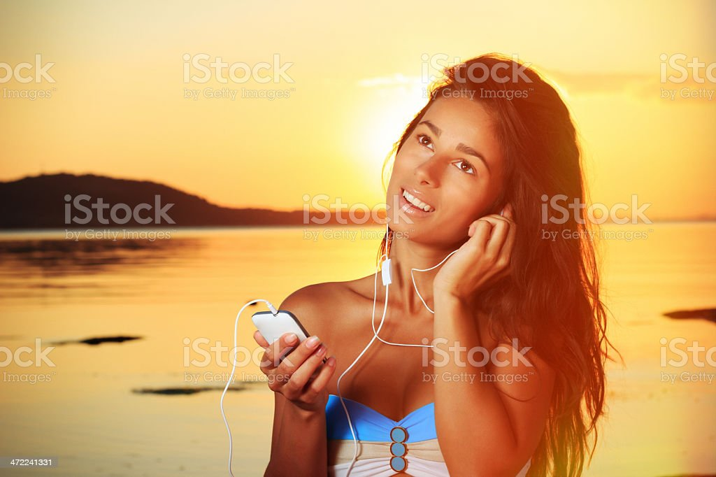 Young girl on the beach royalty-free stock photo