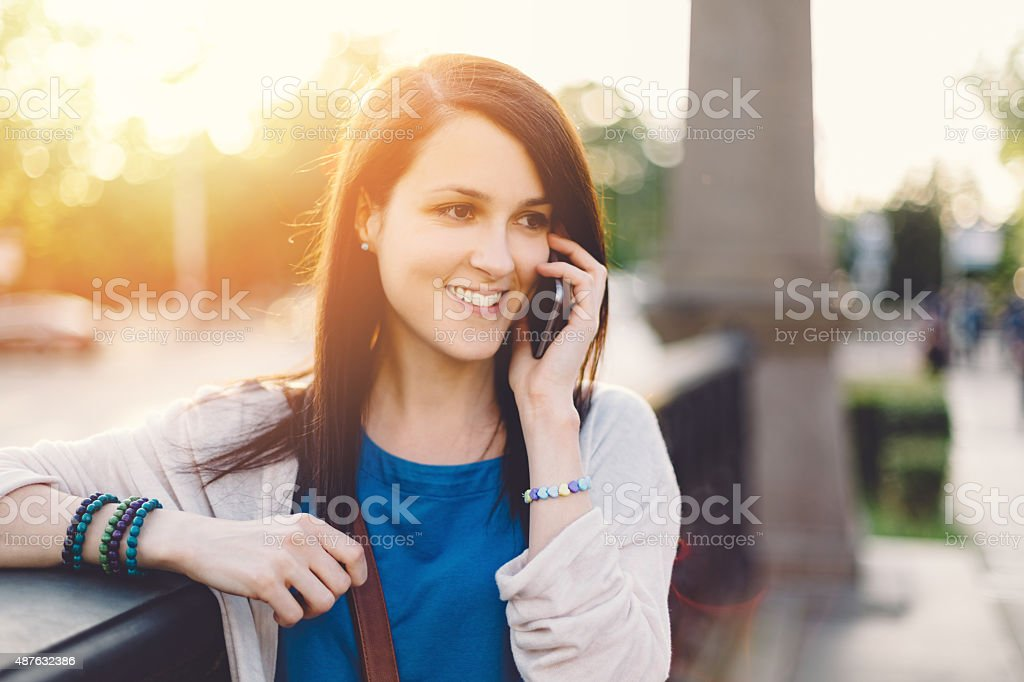 Young girl on the phone stock photo