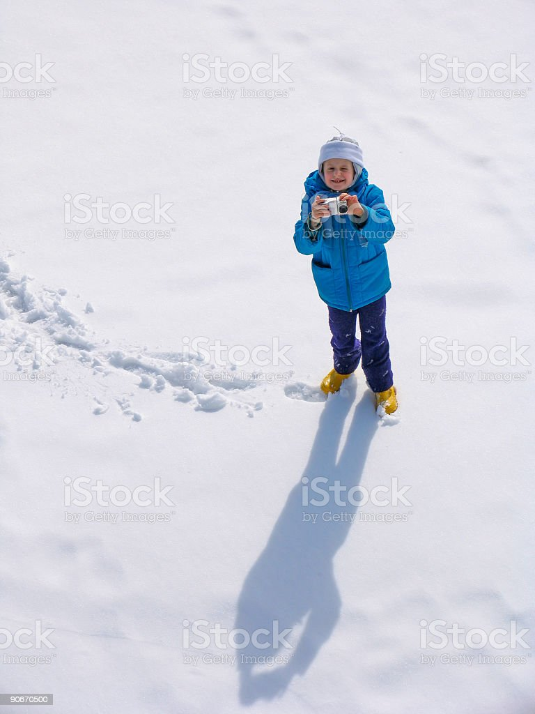 Young girl on the snow field stock photo