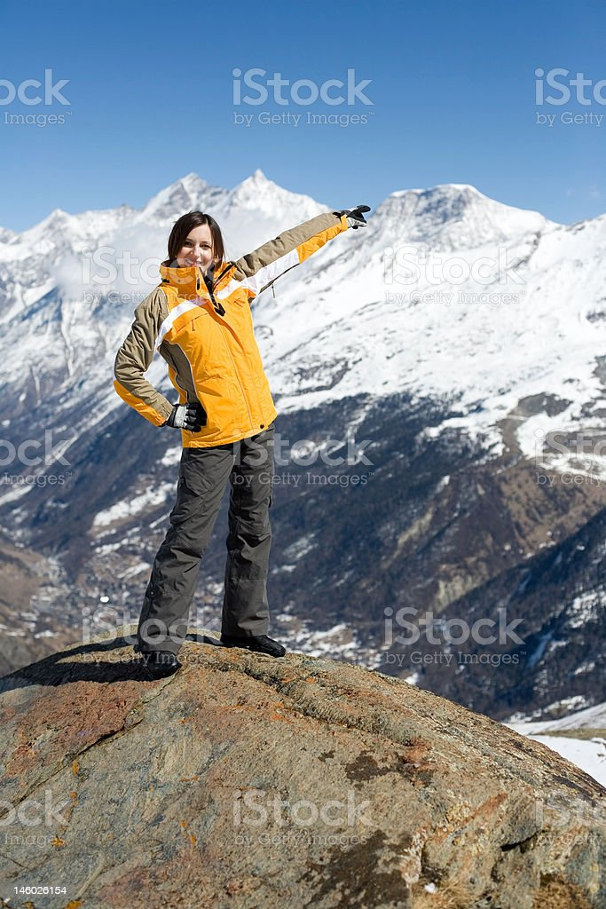 Young girl on the top of mountain royalty-free stock photo