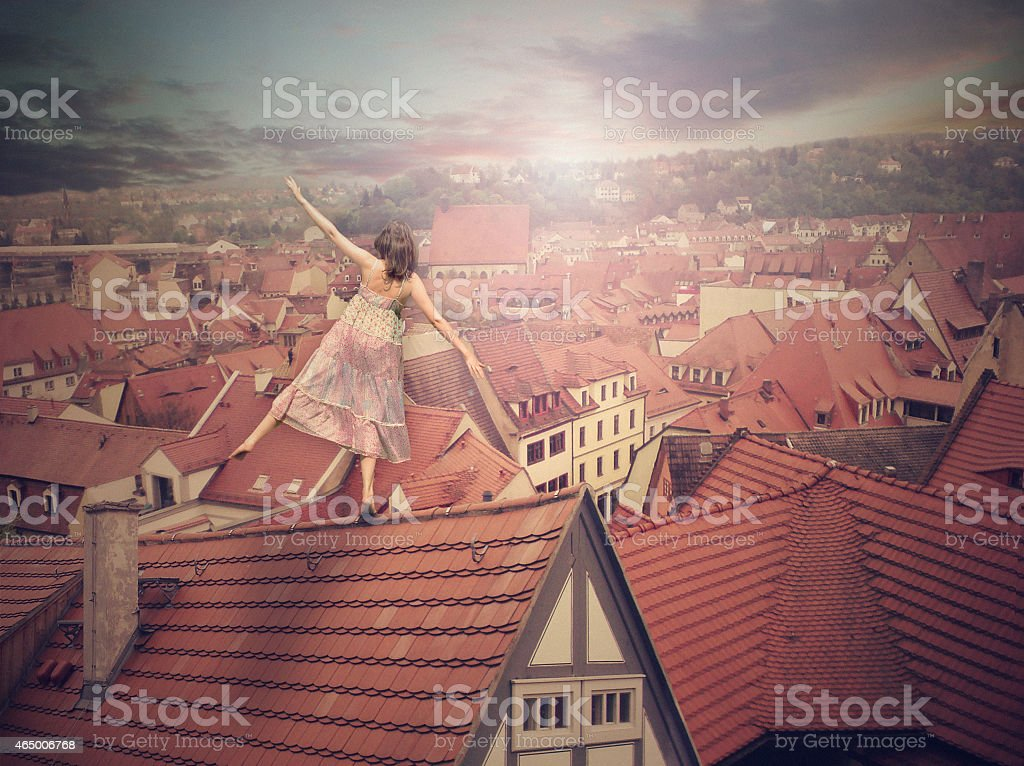 Young girl on top of the roof. Photomanipulation. Concept graphic stock photo
