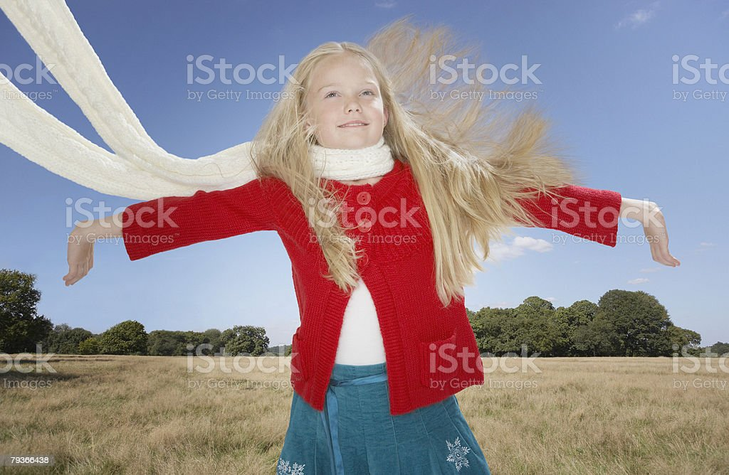 Young girl outdoors jumping royalty-free stock photo