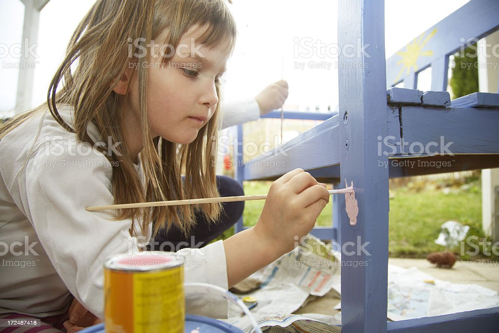 Young girl painting a flower royalty-free stock photo