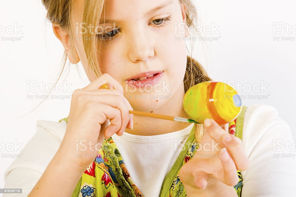 Young girl painting easter eggs stock photo