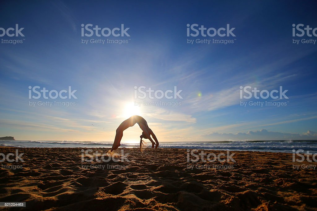 Young Girl performing Gymnastics on the Beach royalty-free stock photo