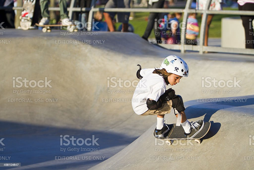 Young Girl Performing In Front Of Crowd At Skateboard Park stock photo