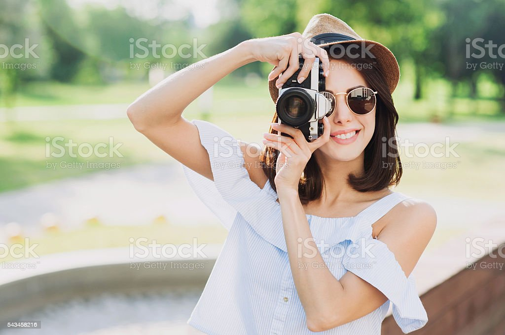 Young girl photographer looking at camera stock photo