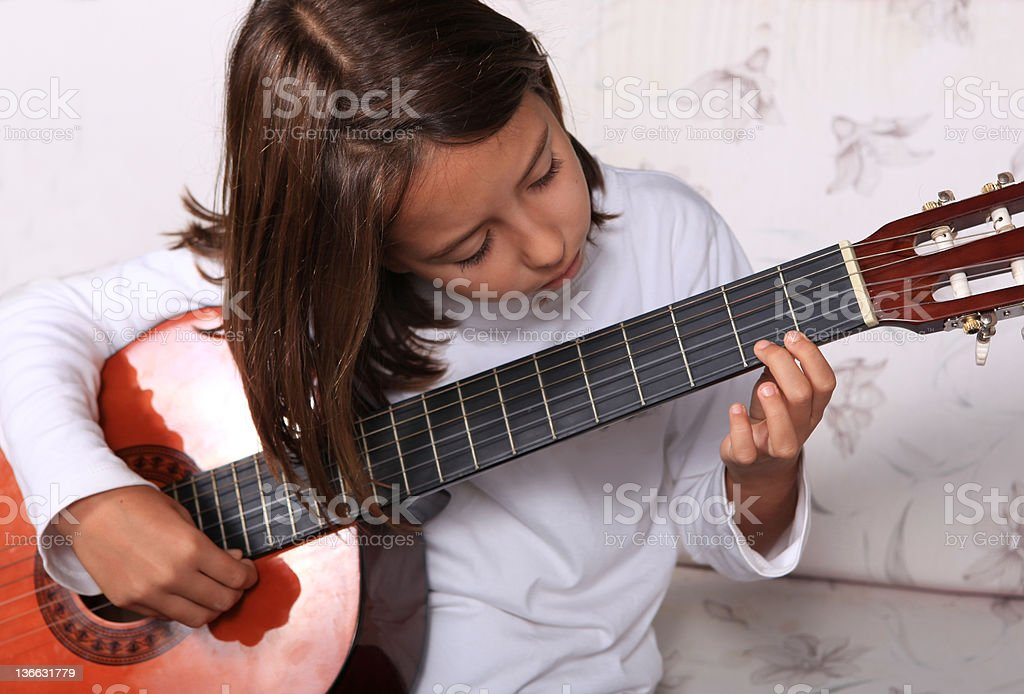 Young girl play classical guitar royalty-free stock photo