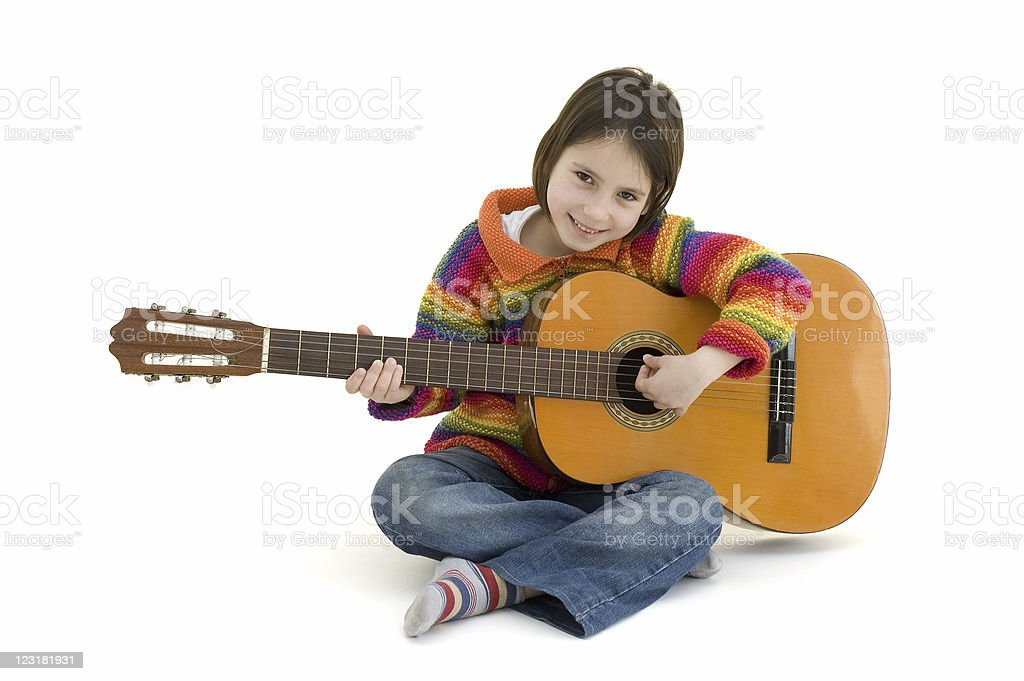 Young girl playing an acoustic guitar on white background royalty-free stock photo