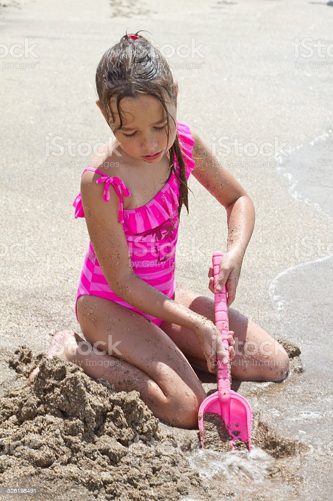 young girl playing at the beach stock photo