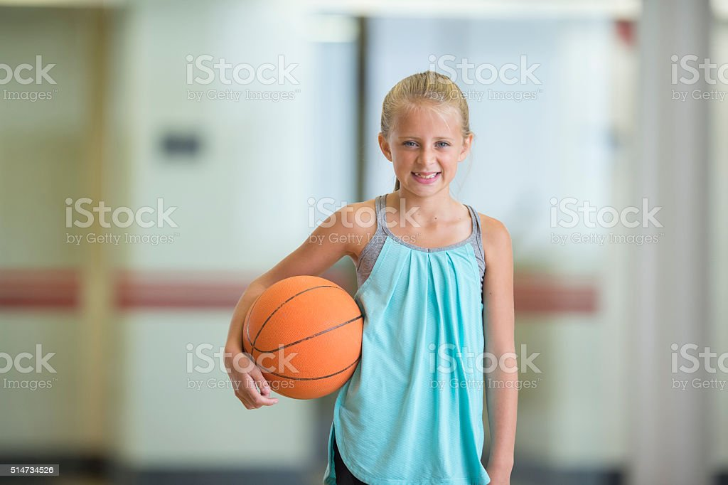 Young Girl Playing Basketball stock photo
