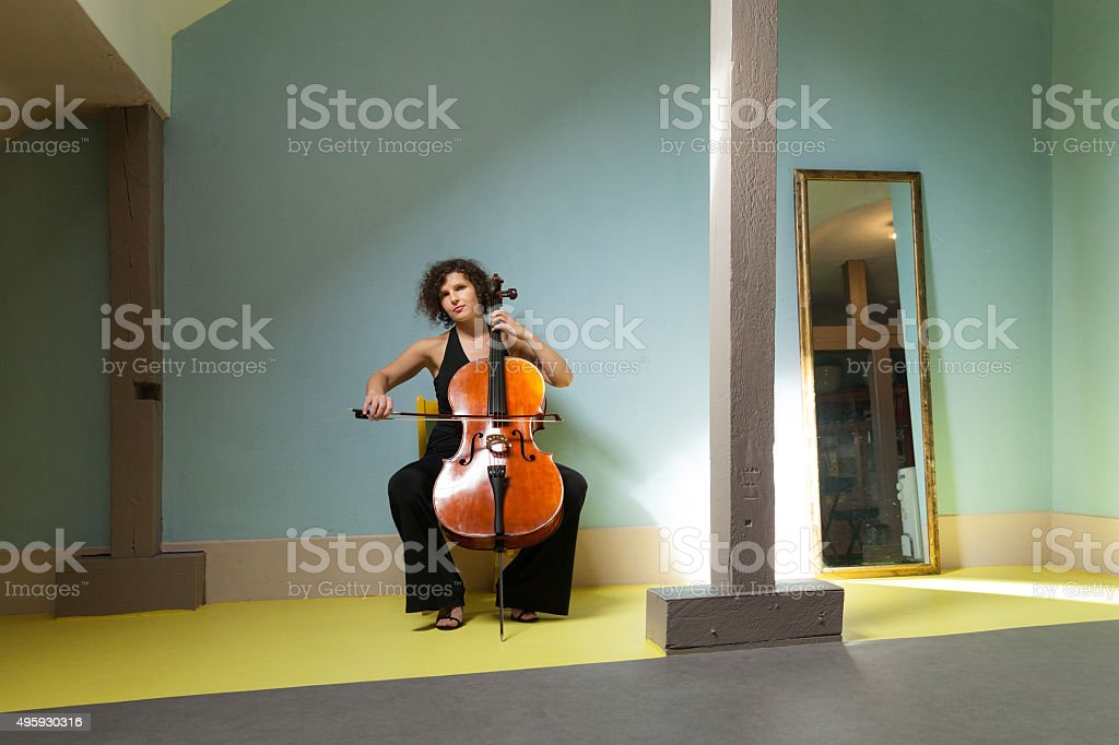 young girl playing cello stock photo