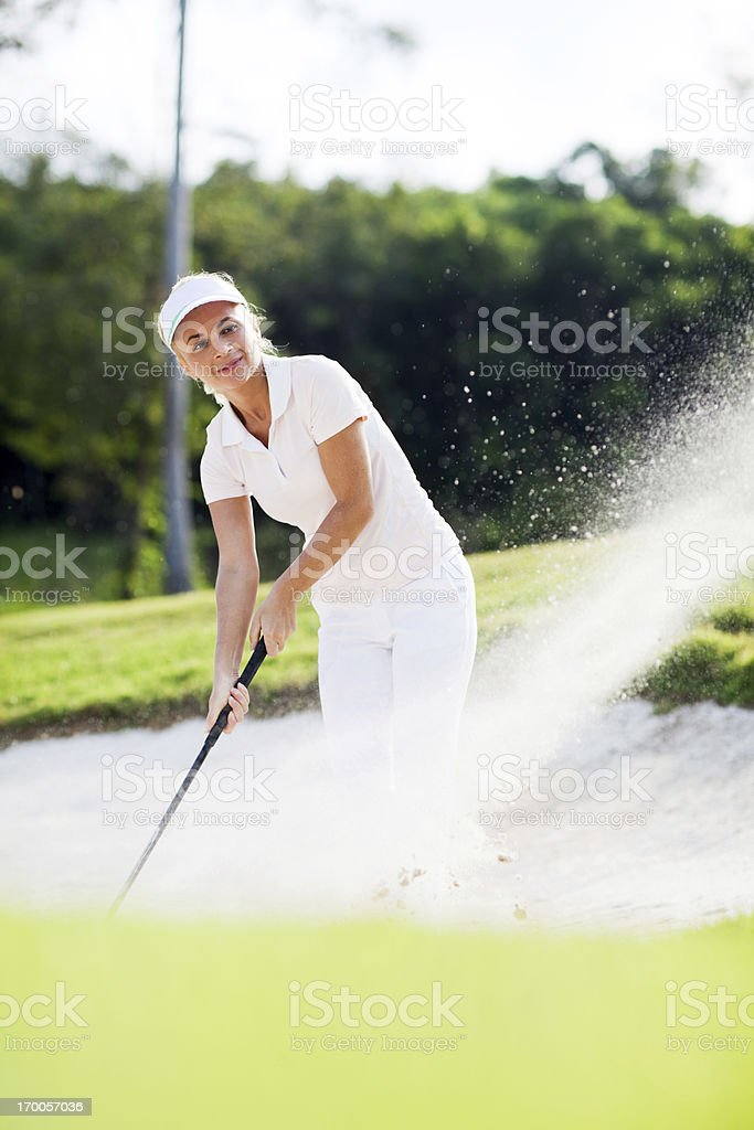 Young girl playing golf outdoor. royalty-free stock photo