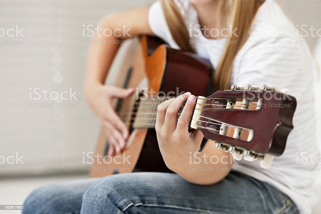 Young Girl Playing Guitar royalty-free stock photo
