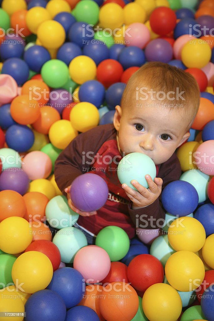 Young girl playing in a ball pool royalty-free stock photo