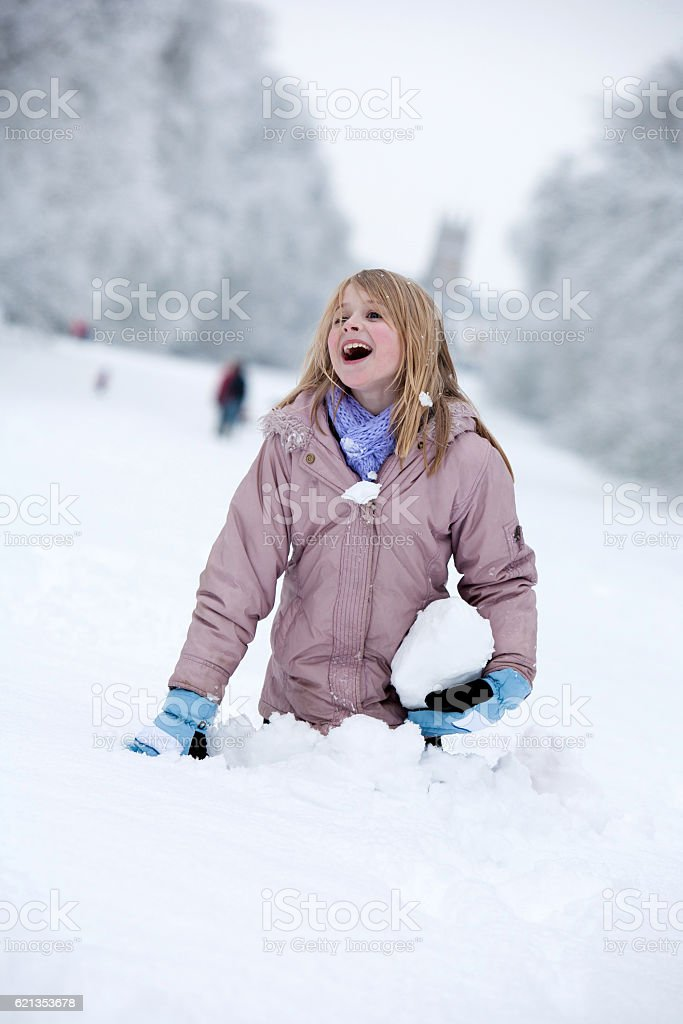 Young girl playing in deep snow stock photo