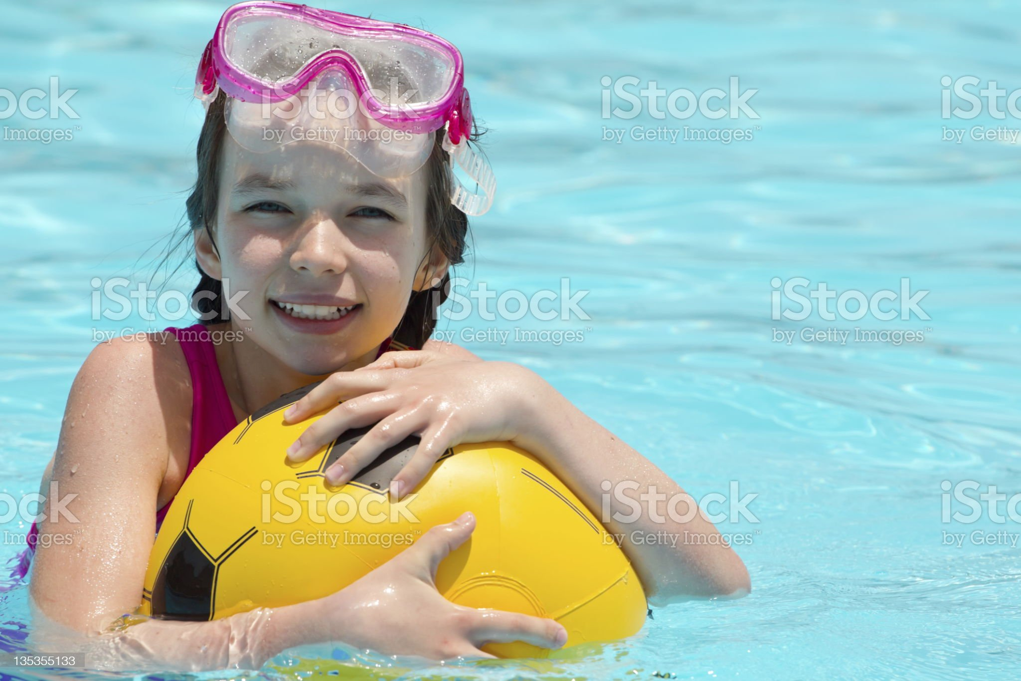 Young girl playing in pool royalty-free stock photo