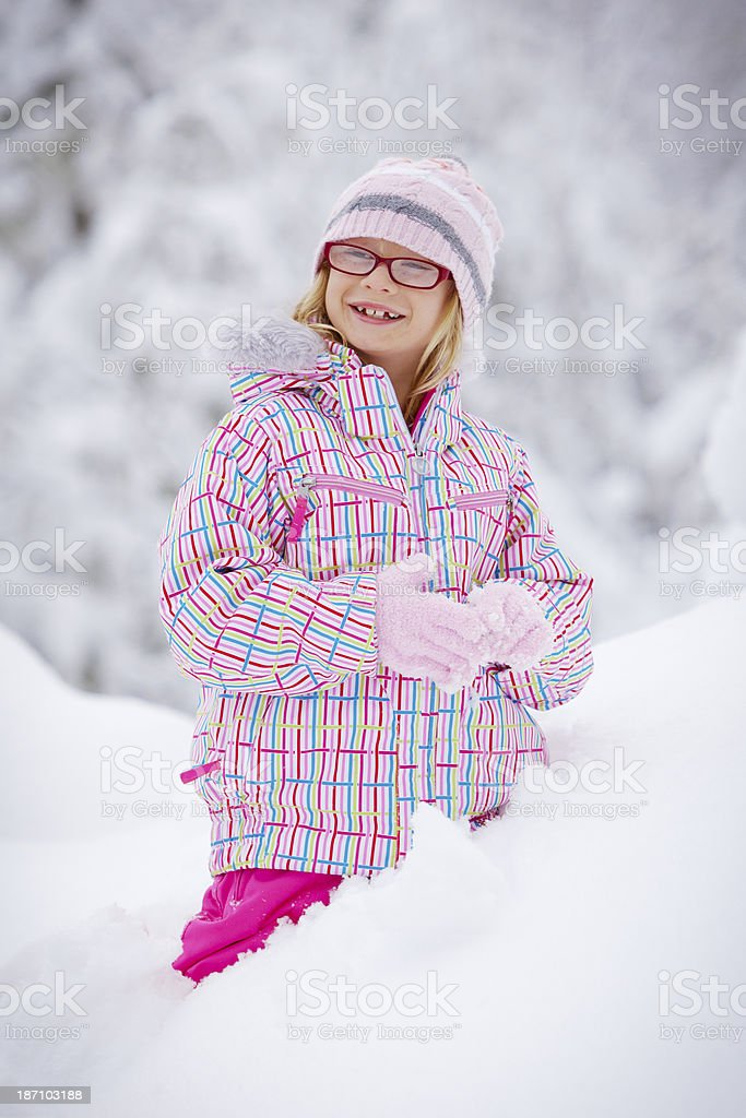Young girl playing in snow. royalty-free stock photo