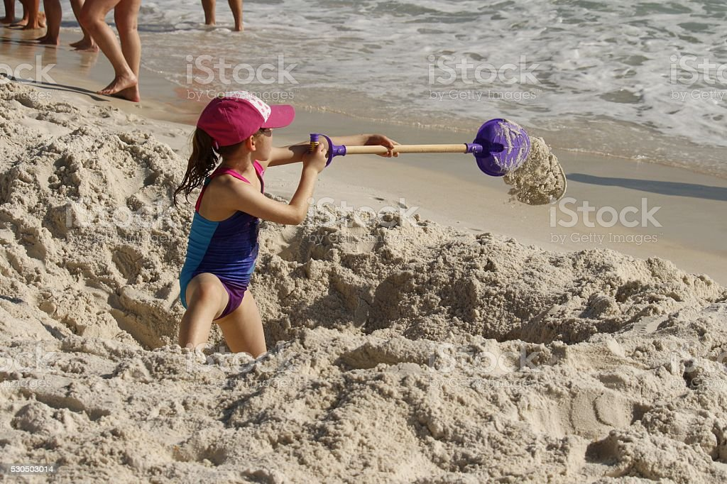 Young Girl Playing on the Beach stock photo
