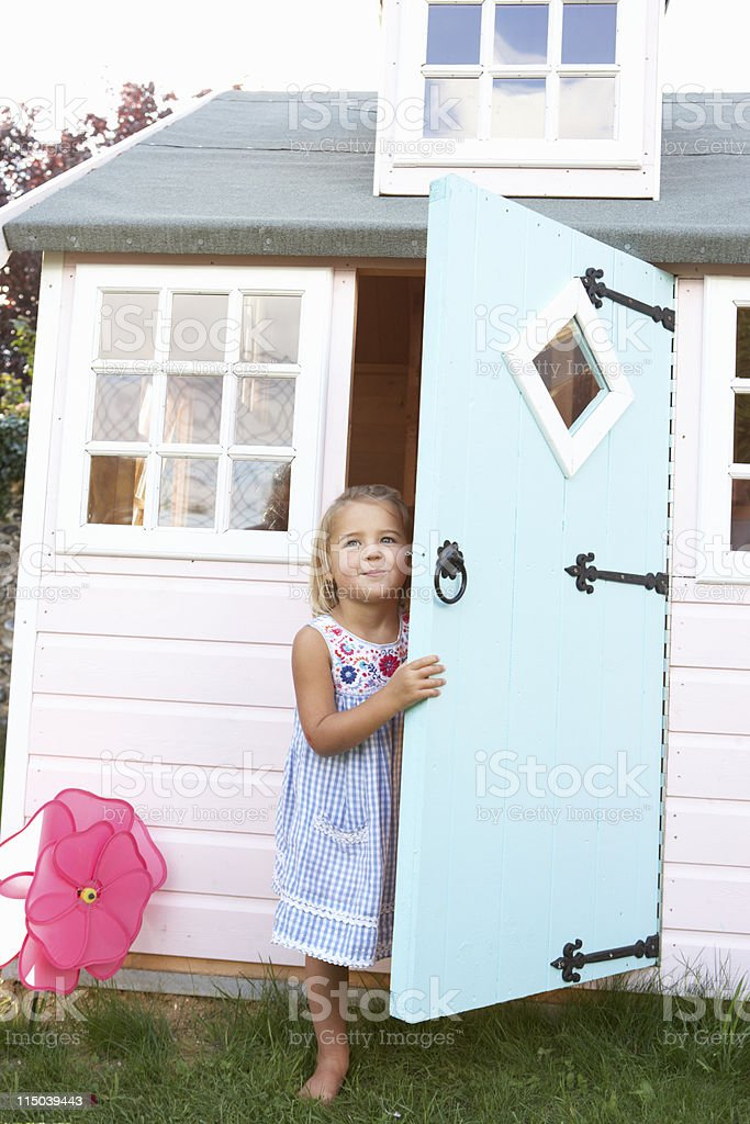 Young girl playing outdoors stock photo