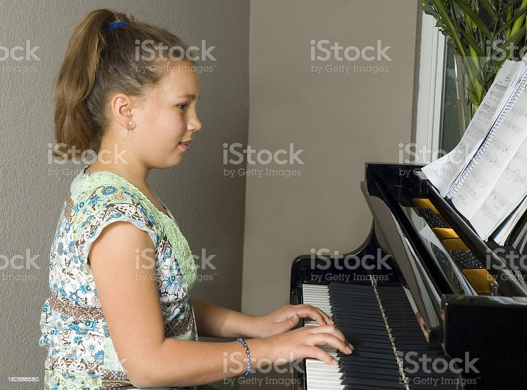 Young Girl Playing Piano royalty-free stock photo