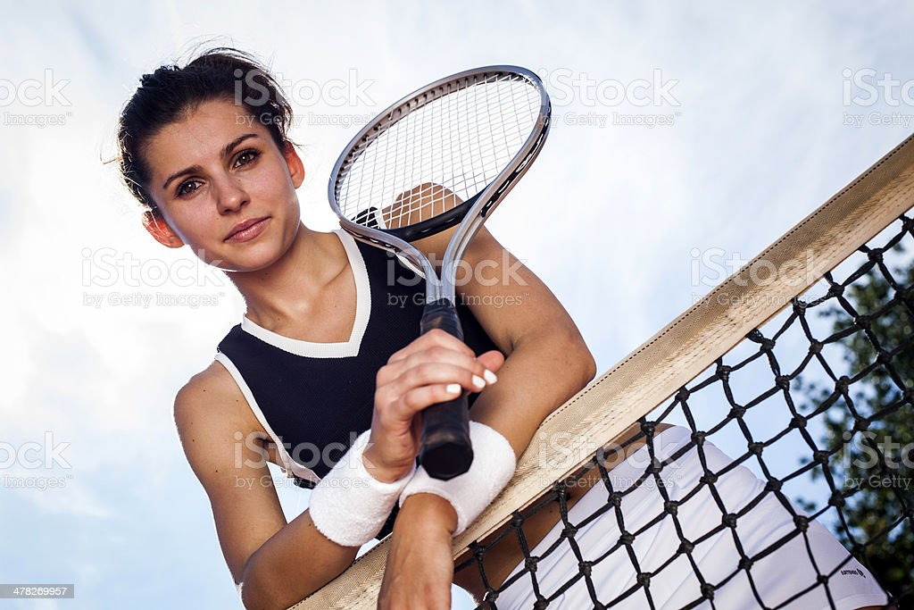 Young girl playing tennis at the beautiful weather royalty-free stock photo
