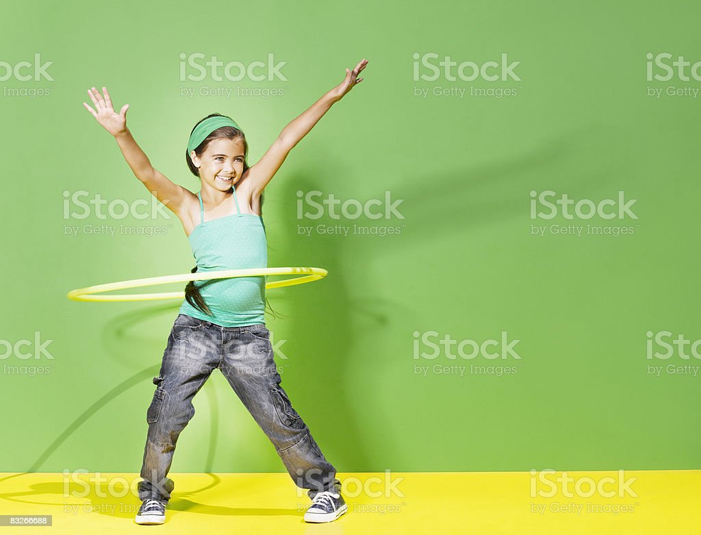 Young girl playing with hula hoop stock photo
