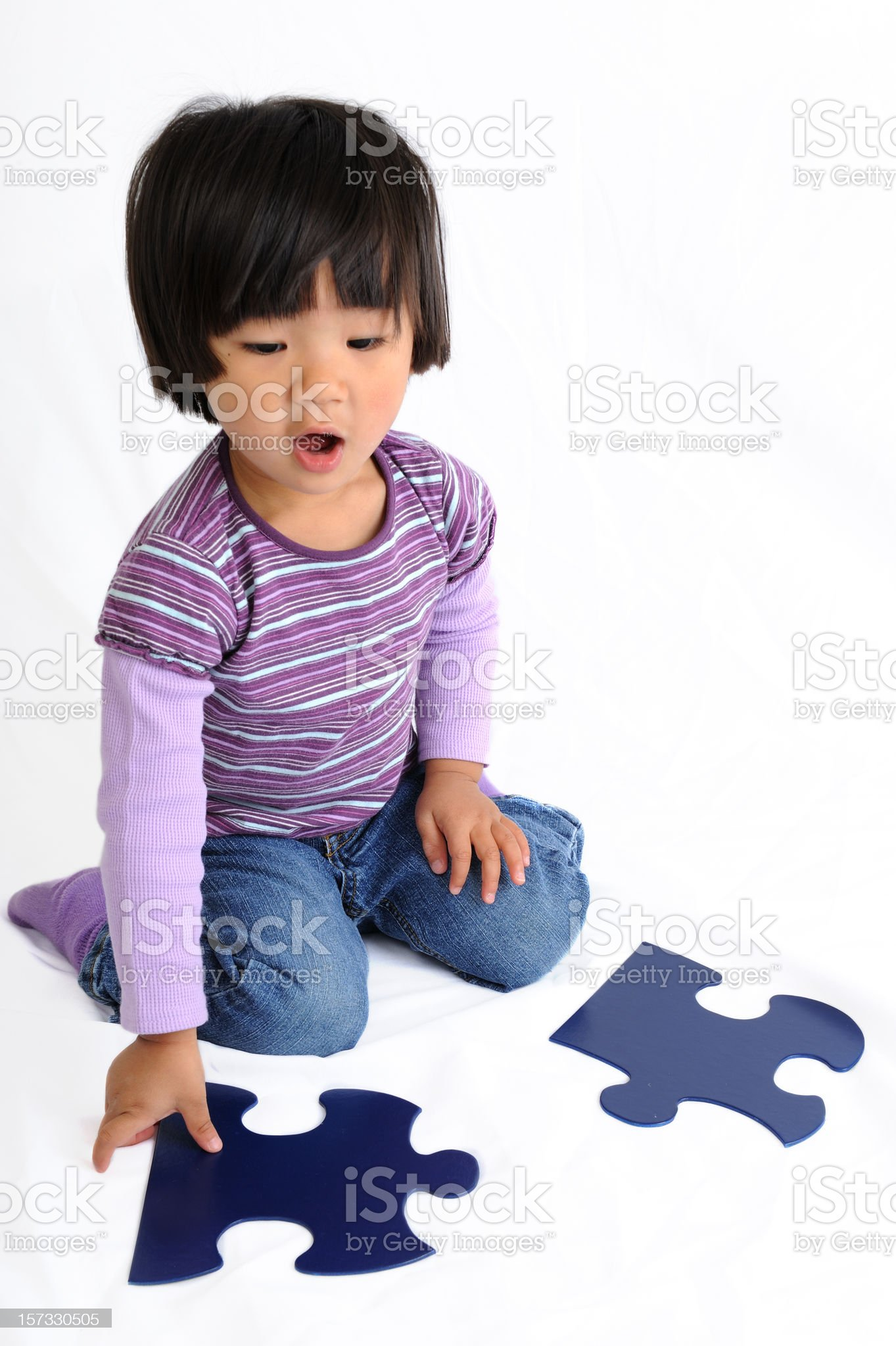 Young Girl Playing With Puzzle Pieces royalty-free stock photo