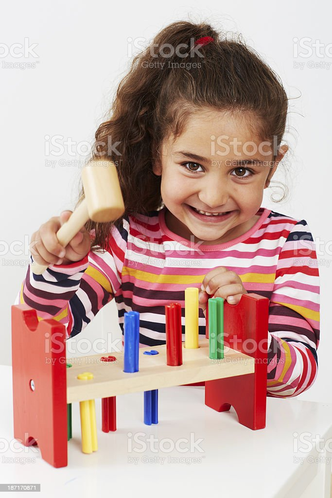 Young girl playing with wooden toy royalty-free stock photo