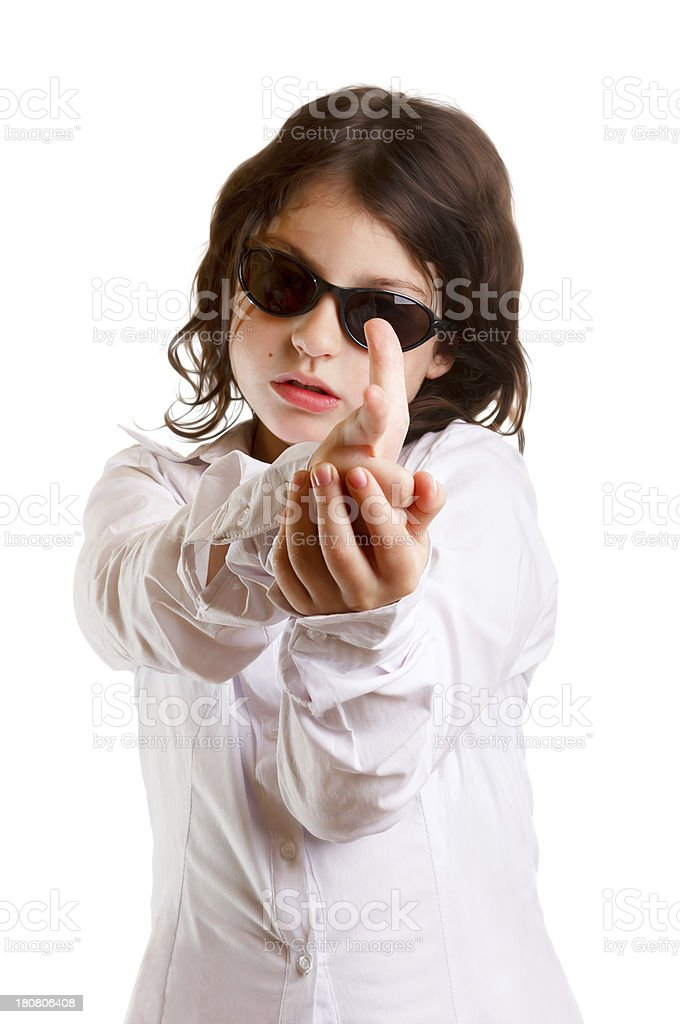 Young Girl pointing with finger guns stock photo