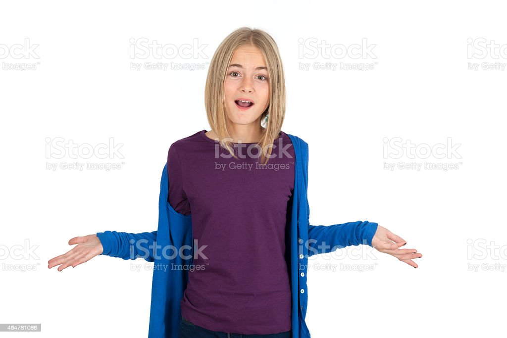 Young girl posing against a white background stock photo