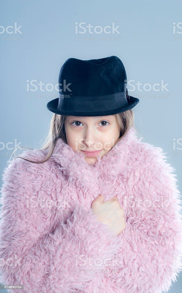 Young girl posing in winter coat stock photo
