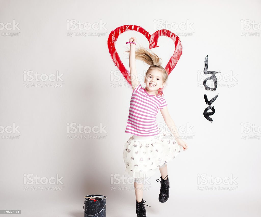 Young Girl Posing on Background with Heart and Love royalty-free stock photo