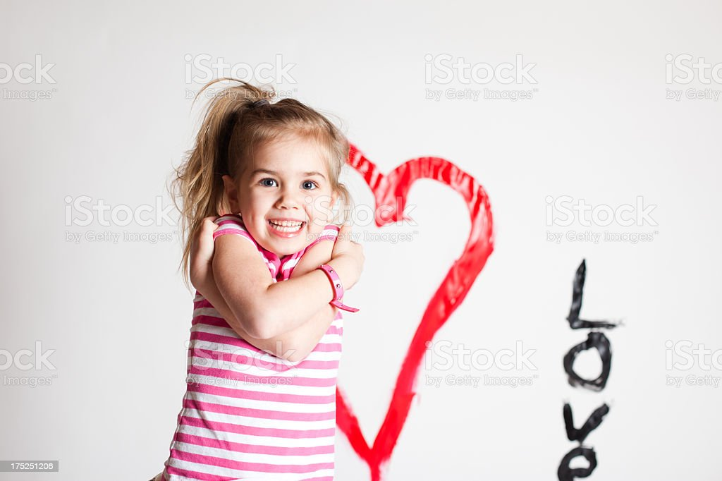 Young Girl Posing on Background with Heart and Love stock photo