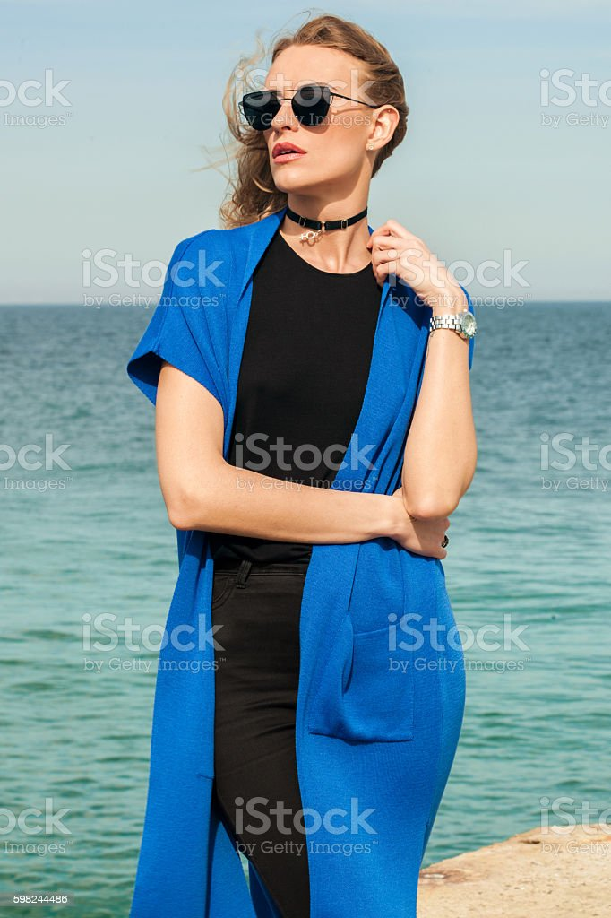 Young girl posing on the beach stock photo