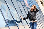 Young girl posing on the pedestrian bridge