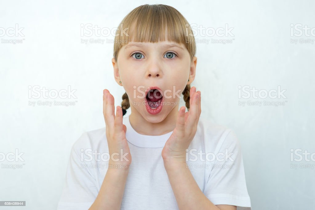 Young girl posing on white background isolated stock photo