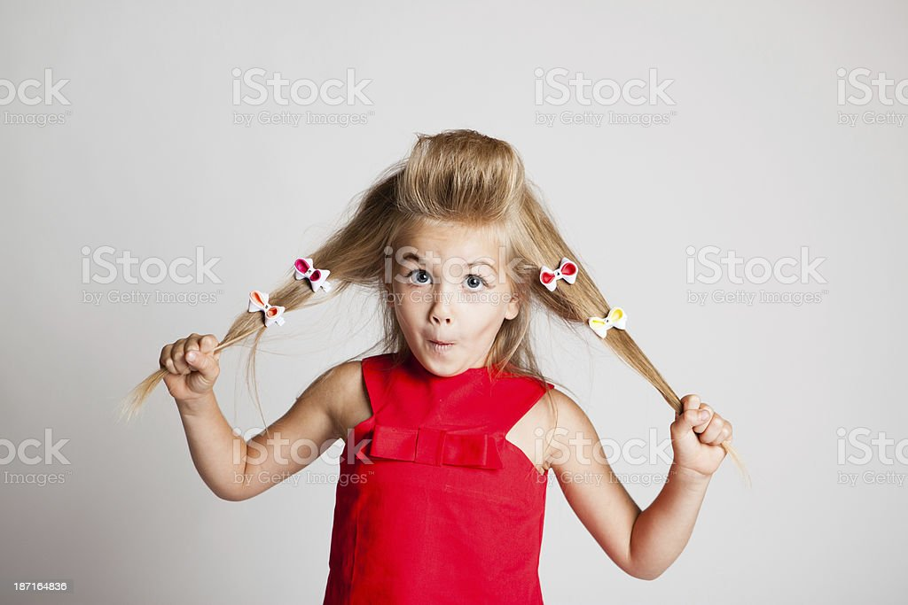 Young Girl Posing on White Background stock photo