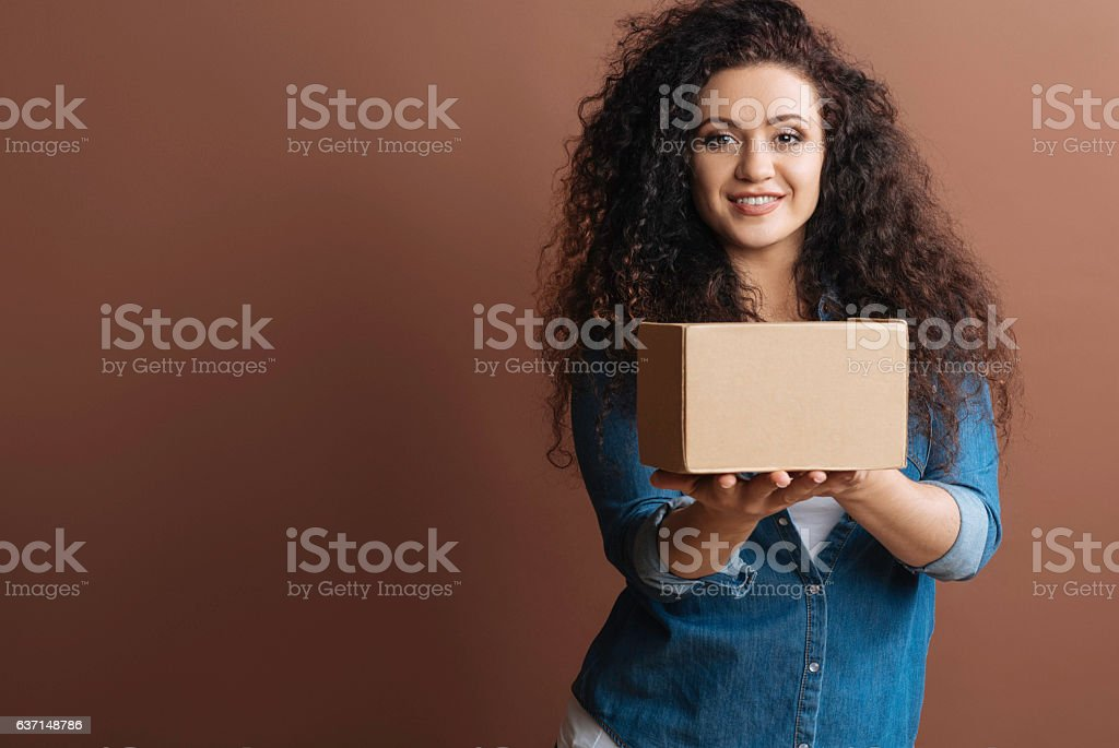 Young girl posing with parcel stock photo