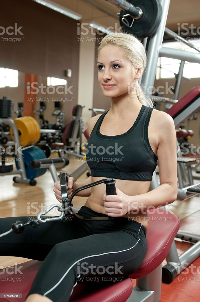 Young girl practicing in the gym royalty-free stock photo