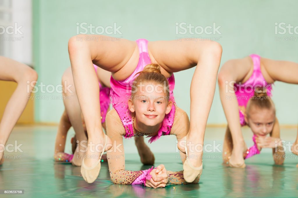 Portrait of young Caucasian girl practicing rhythmic gymnastics in gym