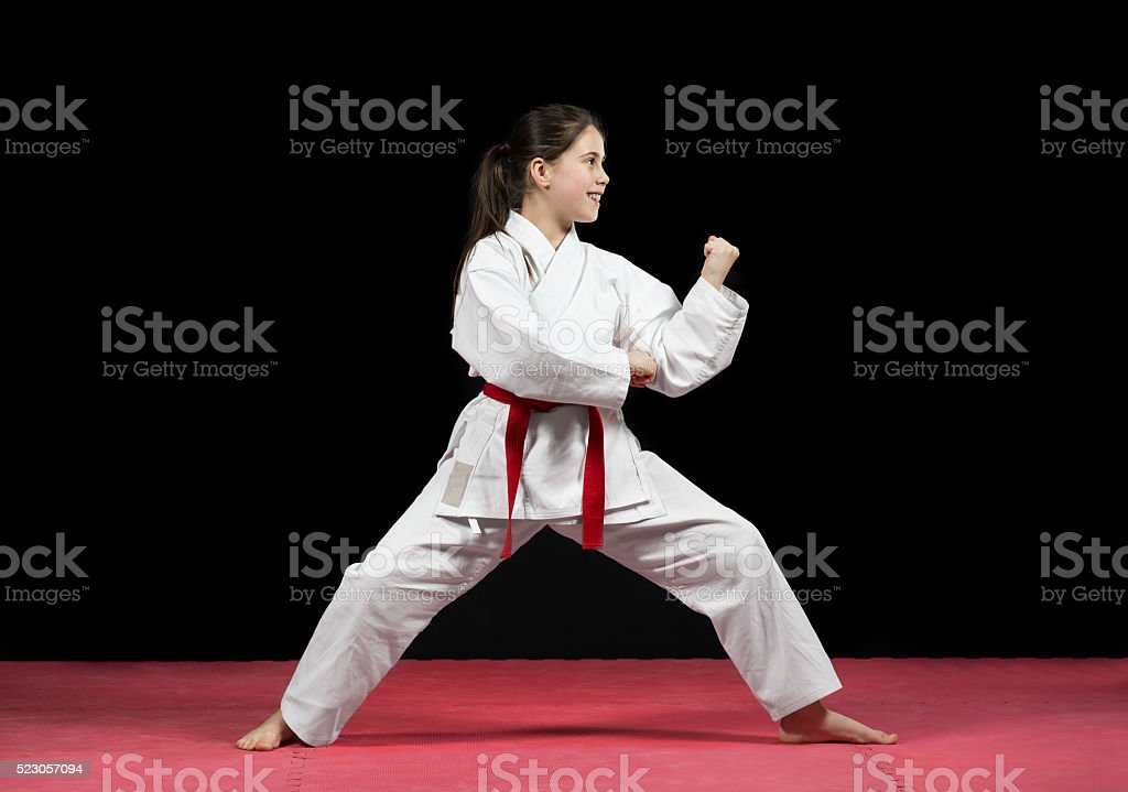 Young girl preforming karate martial arts stock photo