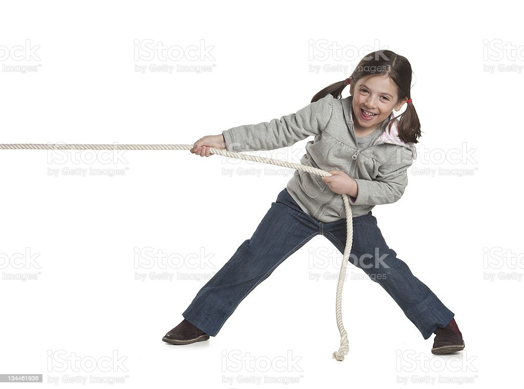 young girl pulling a rope stock photo