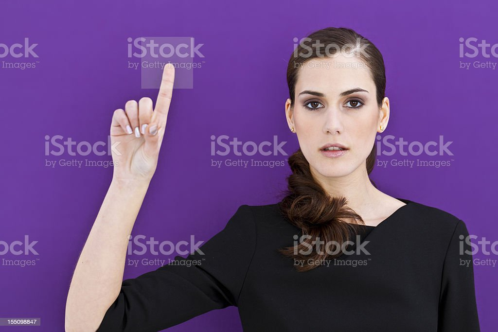 Young girl pushing access button royalty-free stock photo