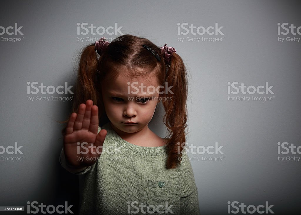 Young girl raising a hand to demand an end to violence stock photo
