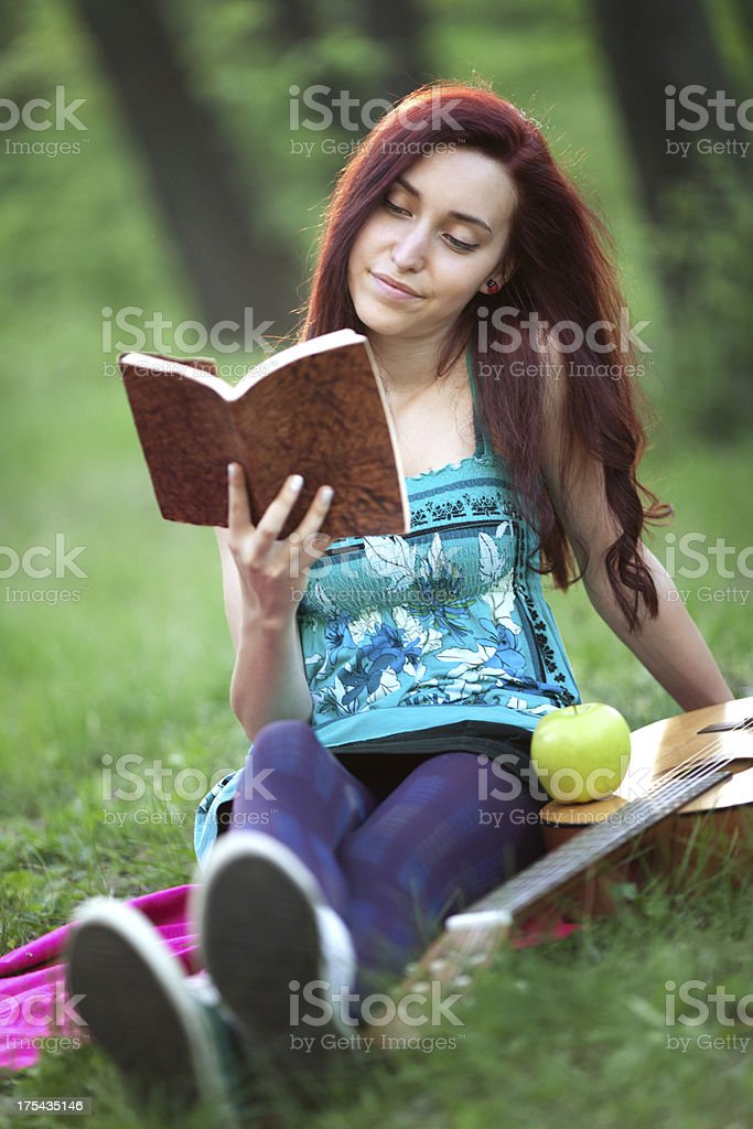 young girl reading a book royalty-free stock photo