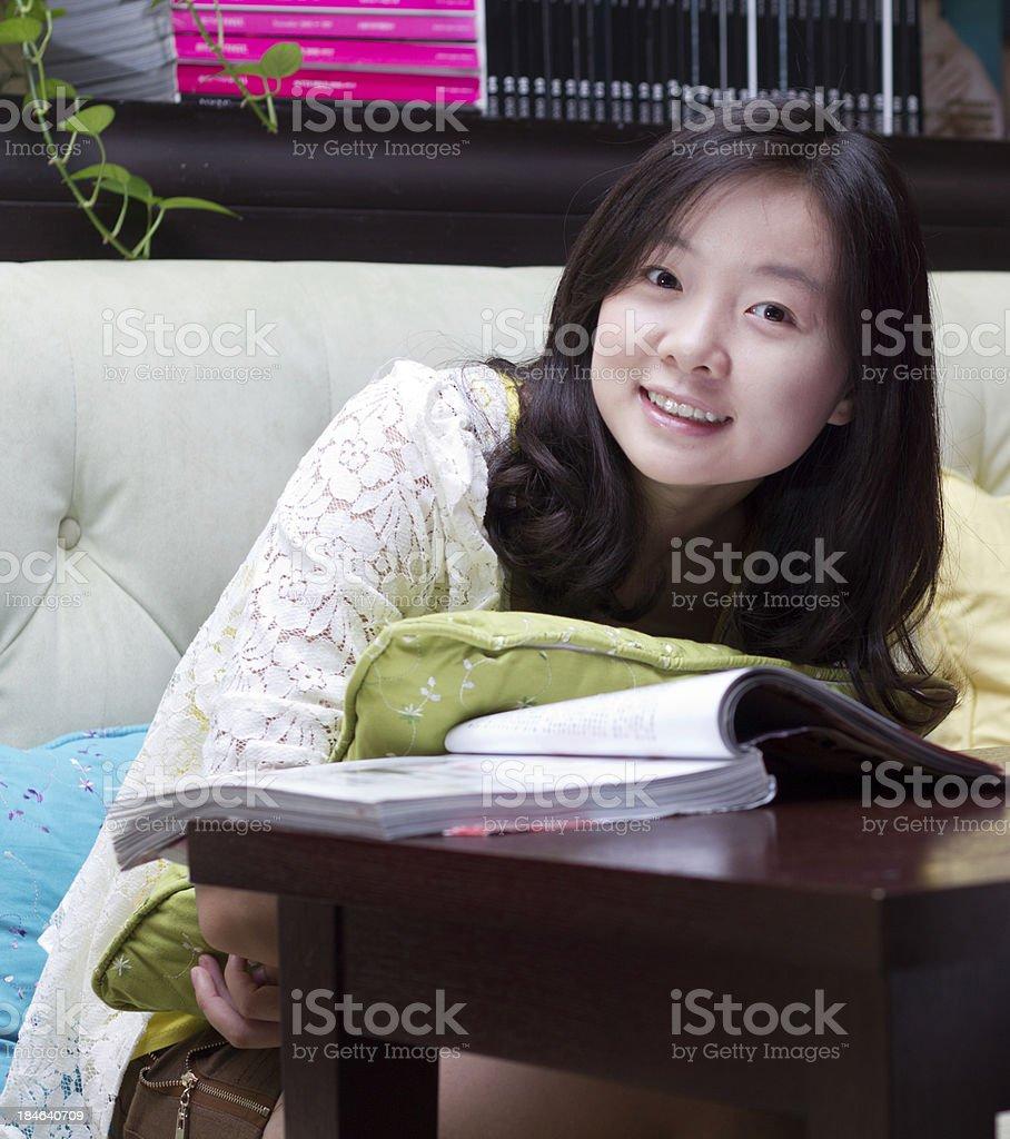 Young girl reading Magazine royalty-free stock photo