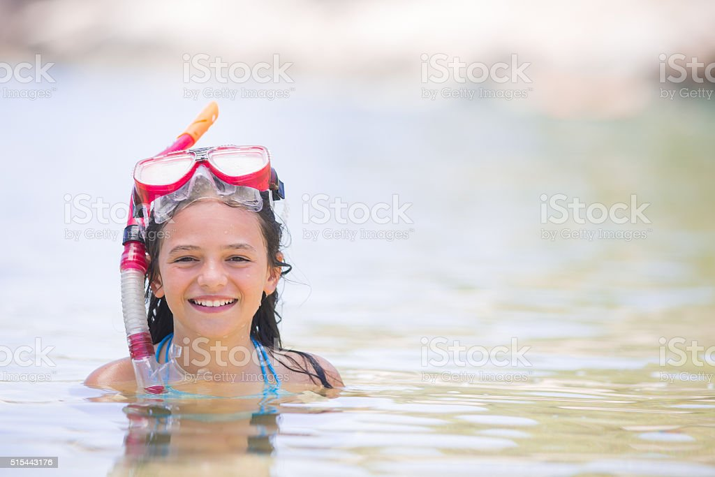 Young girl ready for snorkelling in an idilic island. stock photo