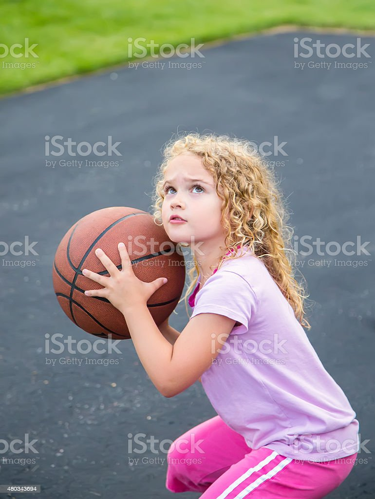 Young Girl Ready To Shoot Basketball stock photo